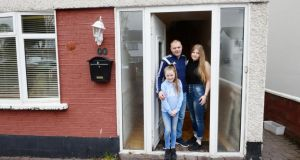 Daniel O'Connor with his daughters, Stacy and Sophie, at their home in Tallaght after finally getting their mortgage-to-rent approval after 100 hours of negotiations. Photograph: Alan Betson
