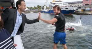 Taoiseach Leo Varadkar gives a high-five  to flyboarder Beau Weston  at SeaFest 2017 in Galway. Photograph: Joe O'Shaughnessy