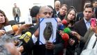 A security officer of the supreme court shows an image of a type of grenade that President Nicolas Maduro's government say rogue policemen used to attack the court and interior ministry. Photograph: Marco Bello/Reuters