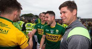 Kerry's Shane Enright, Michael Geaney and manager Eamonn Fitzmaurice celebrate after the game. Photo: Cathal Noonan/Inpho