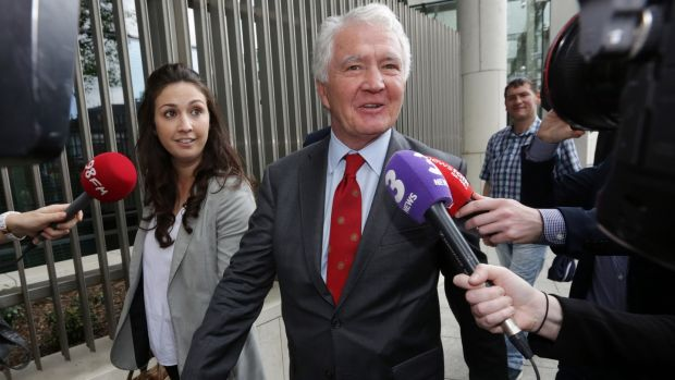 Former chairman of Anglo Irish Bank Seán FitzPatrick with his daughter Sarah at Dublin Circuit Criminal Court after he was acquitted on all charges. Photograph: Collins Courts