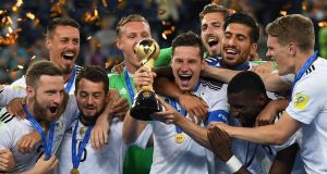Germany's midfielder Julian Draxler lifts the trophy after winning the 2017 Confederations Cup. Photo: Patrik Stolarz/Getty Images