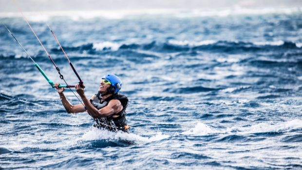 Barack Obama kitesurfing in the Caribbean. Photograph: Getty Images
