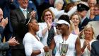 Serena and Venus Williams celebrate their sixth Wimbledon women's doubles title. Photograph: Lindsey Parnaby/Getty