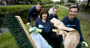 "Salesforce staff taking part in the company's ""Canal Clean  Up"" event at Binn's Bridge, Dublin. Photograph: Colm Mahady/Fennells"