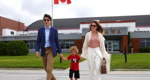 Canada's prime minister Justin Trudeau with his son Hadrien and wife Sophie Gregoire Trudeau in Ottawa boarding a plane for Dublin on Monday. Photograph: Ryan Remiorz/The Canadian Press via AP