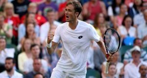 Daniil Medvedev celebrates winning the third set against Stan Wawrinka on day one of the Wimbledon Championships. Photograph: Steven Paston/PA Wire