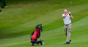 John Marshall in  action on the 18th fairway at the Malone Golf Club in Belfast. Picture By: Arthur Allison.