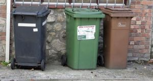 The new bin charges proposals allow for the abolishing of a flat-rate fee imposed on householders by some waste companies. Instead, homeowners would have the option of paying by lift or paying by weight. Photograph: Alan Betson/The Irish Times