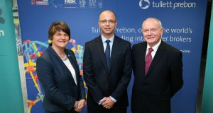 Arlene Foster and Martin McGuinness join Tullett Prebon group CIO Luke Barnett at Invest NI headquarters in Belfast