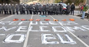 """Refugees welcome to EU"" is painted on a street  in thevillage of Brenner on the Italian-Austrian border in April 2016. Austria's defence minister said his country will deploy armoured vehicles at  the key Alpine pass to stop migrants arriving from Italy.  Photograph: Kerstin Joensso/AP Photo"