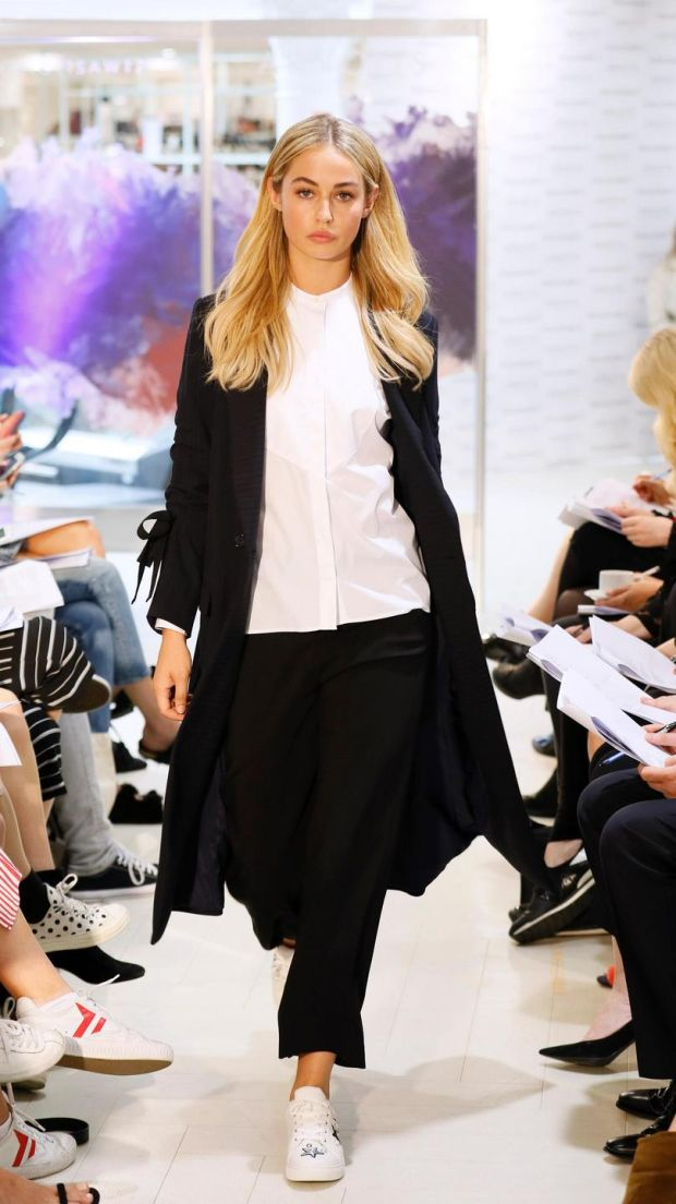 no fee if Arnotts mentioned in caption at the Arnotts Autumn Winter 2017 Womenswear Show-photo Kieran HarnettThalia Navy long pinstripe coat, HUGO Hugo Boss, €599White grandad collar shirt, Gant, €135Black cropped tailored trousers, Reiss, €210Trainers by Kurt Geiger