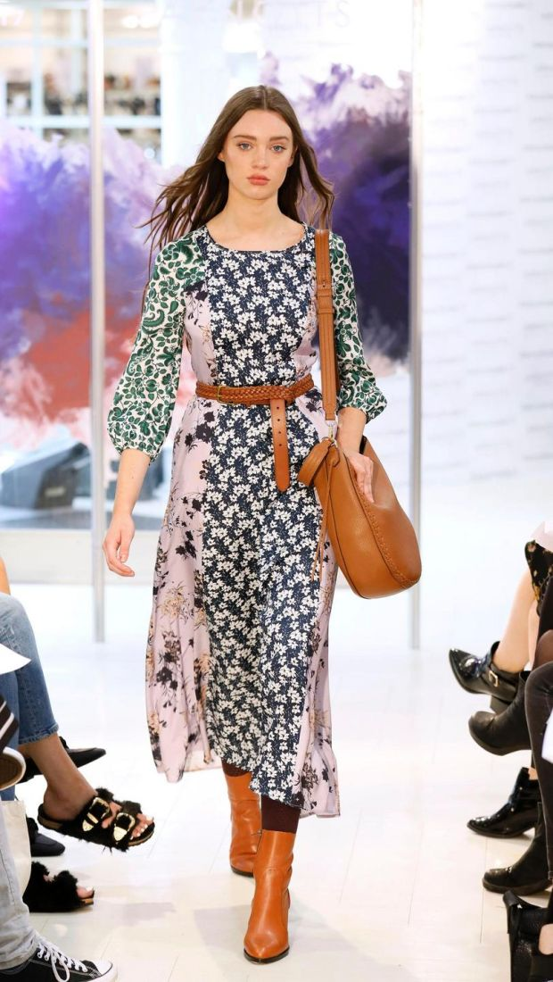 no fee if Arnotts mentioned in caption at the Arnotts Autumn Winter 2017 Womenswear Show-photo Kieran HarnettNiamh Multi floral print dress, Max&Co, €259Belt, Ralph Lauren, €48Tan leather bag, Rebecca Minkoff, €423Boots by Buffalo