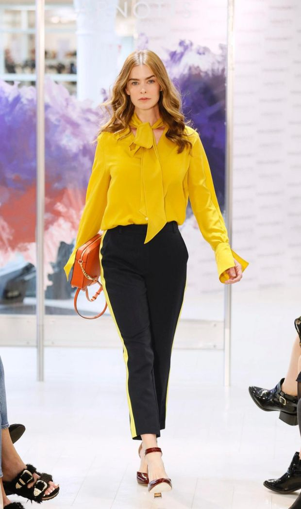 no fee if Arnotts mentioned in caption at the Arnotts Autumn Winter 2017 Womenswear Show-photo Kieran HarnettNiki Yellow silk blouse, Luisa Cerano, €310Navy with yellow stripe trousers, Millie Mackintosh, €100Orange crossbody bag, Michael Kors, €175Shoes by Vince Camuto