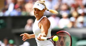 Germany's Angelique Kerber plays a forehand during her first-round match  against Irina Falconi of the United States on day two of  Wimbledon. Photograph:    Michael Steele/Getty Images