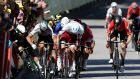 Peter Sagan elbows Mark Cavendish into the railings during thre sprint finish to stage four of the Tour de France. Sagan was disqualified from the tour for his actions. Photograph: Yoan Valat/EPA