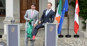 Taoiseach Leo Varadkar models his maple-leaf- and Mountie-emblazoned socks alongside Canada's prime minister, Justin Trudeau, at Farmleigh on Tuesday. Photograph: Dara Mac Dónaill