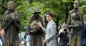 Canada's prime minister Justin Trudeau at  the Famine Memorial on Dublin's Custom House Quay as part of his brief visit to Dublin on Tuesday. Photograph: AFP  / Paul Faith/Getty Images