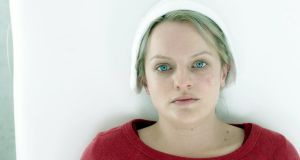 Chilling timeliness:  Elizabeth Moss as Offred  in The Handmaid's Tale