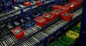 Ocado reported a 9.4 per cent drop in first-half pretax profit due to an increased depreciation charge linked to the opening of a distribution centre in Andover in England.