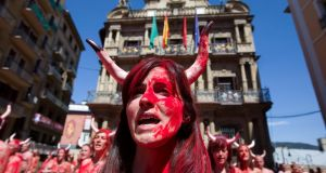 Protesters from  animal rights organisation Peta in front of the town hall in Pamplona, Spain, on Wednesday. They were demonstrating against the treatment of fighting bulls in the city's San Fermín festival, which begins on Thursday. Photograph: Jim Hollander/EPA