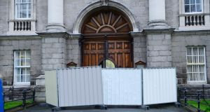 The front gate of Trinity College Dublin was sealed off after a man drove a vehicle into it on April 2nd, 2014. Photograph: Bryan O'Brien/The Irish Times.
