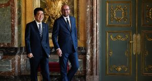 Japan's prime minister Shinzo Abe is welcomed by Belgian counterpart Charles Michel ahead of a meeting in Brussels, Belgium. Photograph: Reuters