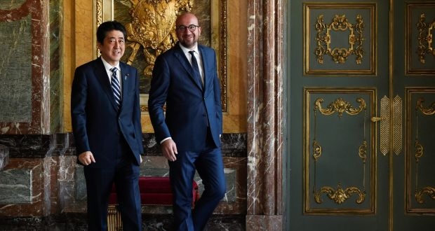 Eu strikes free trade deal with japan japans prime minister shinzo abe is welcomed by belgian counterpart charles michel ahead of a meeting fandeluxe Gallery
