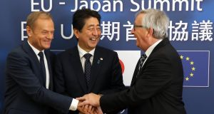 Japan's Prime minister Shinzo Abe with European Council president Donald Tusk (left) and EU Commission president Jean-Claude Juncker. Photograph: EPA
