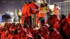 A group of 52 migrants who were rescued  by the Spanish coastguard are met by Red Cross personnel  at Málaga harbour on June 21st. Photograph:  Guillaume Pinon/NurPhoto via Getty Images