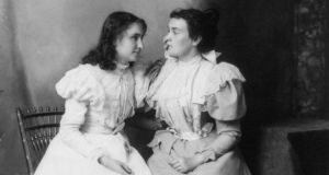 Deaf-blind pioneer: Helen Keller feels the face of her Irish-American teacher, Anne Sullivan, in 1897. Photograph: Notman/Library of Congress