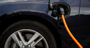 A Volvo hybrid car connected to a charging point: Vehicle charging will have to be commercialised, the ESB has flagged. Photograph: Phil Noble/Reuters