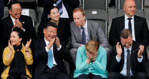 Chinese president Xi Jinping (second left) and his wife Peng Liyuan (left), German chancellor Angela Merkel and Reinhard Grindel, president of the German Football Association, at  a Germany vs China under-12 soccer match at Olympic Park in Berlin, Germany,  July 5th, 2017. Photograph: Ronald Wittek/EPA