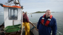 Three men in a boat: fishing for lobster near Howth