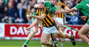 Kilkenny's Pádraig Walsh under pressure from David Dempsey of Limerick in their All-Ireland senior hurling championship match at Nowlan Park. Photograph: Cathal Noonan/Inpho