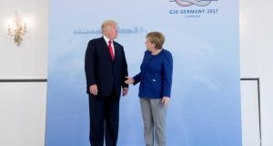 German chancellor Angela Merkel meets US president Donald Trump on the eve of the G20 summit, in Hamburg, Germany. Photograph: Michael Kappeler/Reuters