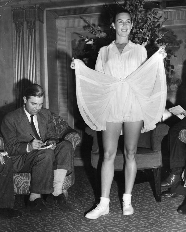 Gertrude 'Gussie' Moran showing off her new bloomer type tennis outfit, specially designed for her by Pierre Balmain, for the Wimbledon championships. (Photo by Keystone/Getty Images)