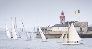 Old and new:  traditional boat entries mix with modern boats for a harbour finish at the Volvo Dún Laoghaire Regatta yesterday. Photograph: David Branigan/Oceansport