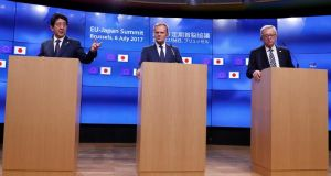 Japan's prime minister Shinzo Abe holds a news conference with European Council president Donald Tusk and European Commission president Jean-Claude Juncker during a EU-Japan summit in Brussels.