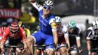 Germany's Marcel Kittel celebrates as he crosses the finish line ahead of Germany's Andre Greipel at the end of the sixth stage of the Tour de France between Vesoul and Troyes. Photograph: Getty Images