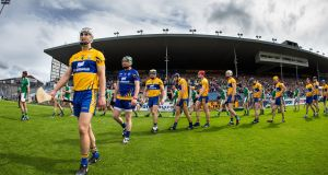 Clare's Patrick O'Connor leads the team during the parade before the Munster senior hurling championship semi-final against Limerick. Photograph: Cathal Noonan/Inpho