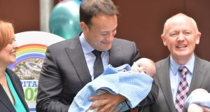 Taoiseach Leo Varadkar, the then minister for health, holding Jace O'Rourke from Kildare at Crumlin Children's Hospital in 2016. Photograph: Alan Betson/The Irish Times