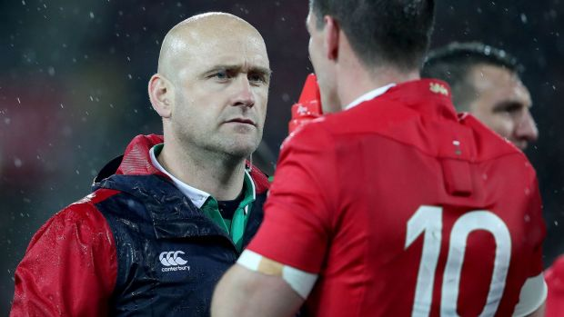 Dr Eanna Falvey talks to Jonathan Sexton during the second test. Photograph: Dan Sheridan/Inpho
