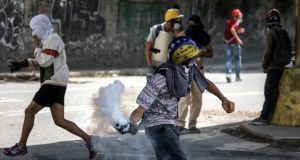 Venezuelan security forces break up opposition protests heading to the supreme court. Photograph: Miguel Gutierrez/EPA