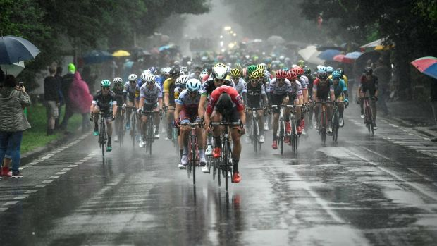 The pack rides in the rain during the second stage. Photograph: Getty Images