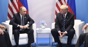 Russia's president Vladimir Putin and US president Donald Trump: Russian foreign minister Sergei Lavrov said Mr Trump accepted Mr Putin's claim of non-interference in polls. Photograph: Saul Loeb/AFP/Getty
