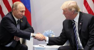 Russian president Vladimir Putin and US president Donald Trump meet on Friday on the sidelines of the G20 summit in Hamburg. Photograph: Michael Klimentyev/EPA