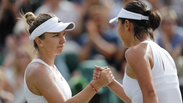 Simona Halep shakes hands with Peng Shuai after their third round clash. Photo: Adrian Dennis/Getty Images