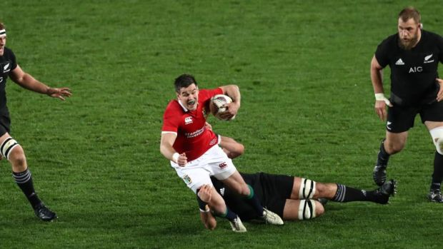 Johnny Sexton of the Lions is tackled by Sam Whitelock. Photograph: David Rogers/Getty Images