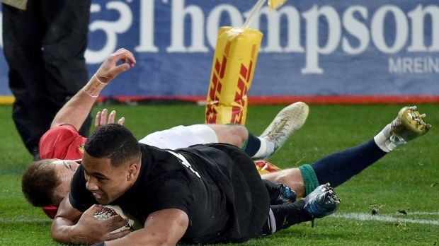 New Zealand's inside centre Ngani Laumape scores the first try . Getty Images
